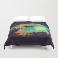 budi Duvet Covers featuring Leap of Faith by Picomodi