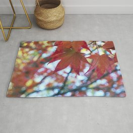 red maple leaves and bokeh Rug