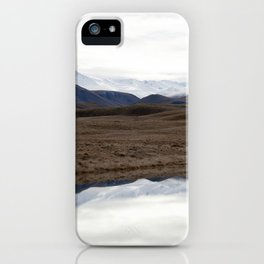 Reflections of the Rolling Hills and Snow-Covered Mountains on the Road to Edoras iPhone Case