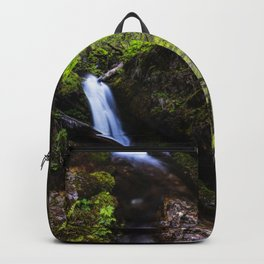 Waterfall in enchanted forest Backpack