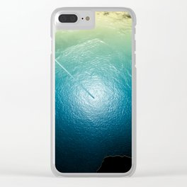 Surrealism landscape, ocean and glacier landscape with an hiker watching over. Clear iPhone Case