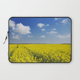 Path through blooming canola under a blue sky with clouds Laptop Sleeve