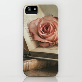 Still life with pink rose and old books iPhone Case