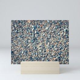 Beach stones surface Mini Art Print