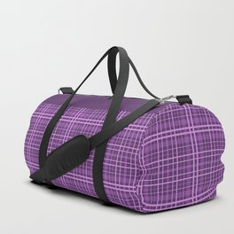 Plaid in black and purple colours . Duffle Bag