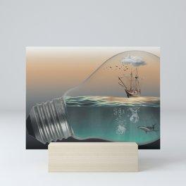 Light bulb with ship Mini Art Print