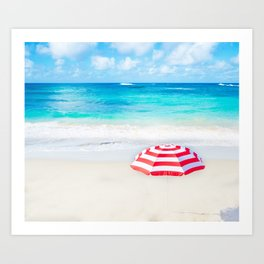 Beach umbrella by the ocean in sunny day Art Print