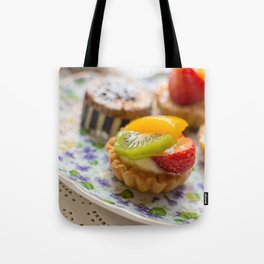 Small fruit tarts laid out on an antique china plate Tote Bag
