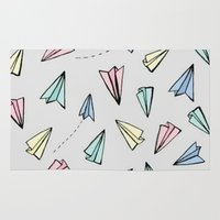 planes Area & Throw Rugs featuring paper planes; by Pink Berry Patterns