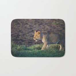 Lion cub in morning light Bath Mat