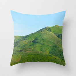 green field and green mountain with blue sky Throw Pillow