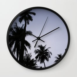 Tropical palm trees in sunset blue Wall Clock