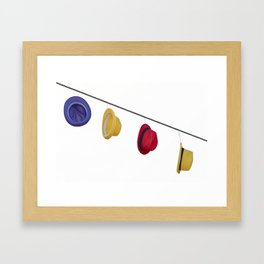isolated colorful hats hanging at the party Framed Art Print