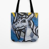 charizard Tote Bags featuring charizard on a card by HiddenStash Art