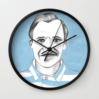 budapest hotel Wall Clocks featuring Ralph Fiennes. The Grand Budapest Hotel.  by Elena O'Neill
