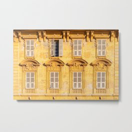 View on rural yellow facade of old building with closed shatters Metal Print