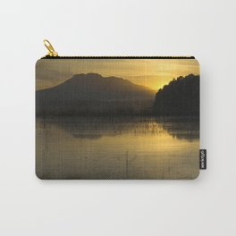 """Sun through the mountains at sunset"" Carry-All Pouch"