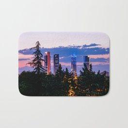 Cityscape of financial district of Madrid at sunset Bath Mat