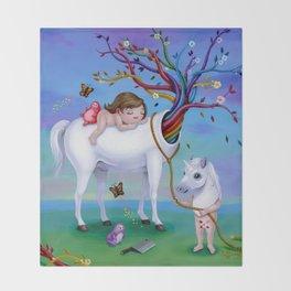 The Unicorn's New Horn Throw Blanket