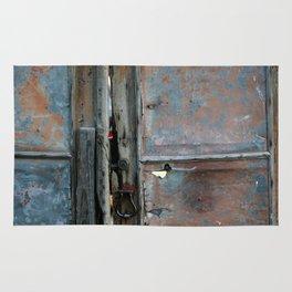 Rusty metal gate Rug