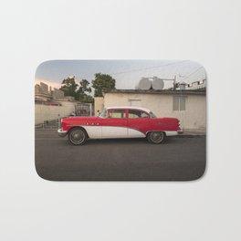 Neat vintage car in Cienfuegos, Cuba. Bath Mat