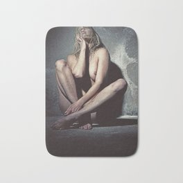 Naked woman in a dark cellar. Image finished with old film grain. Bath Mat