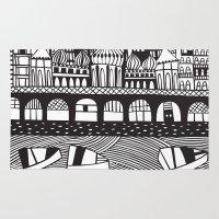 england Area & Throw Rugs featuring Brighton, England by Caroline Rees