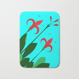 A Garden of Big Red Flowers with Buds with Blue Bath Mat