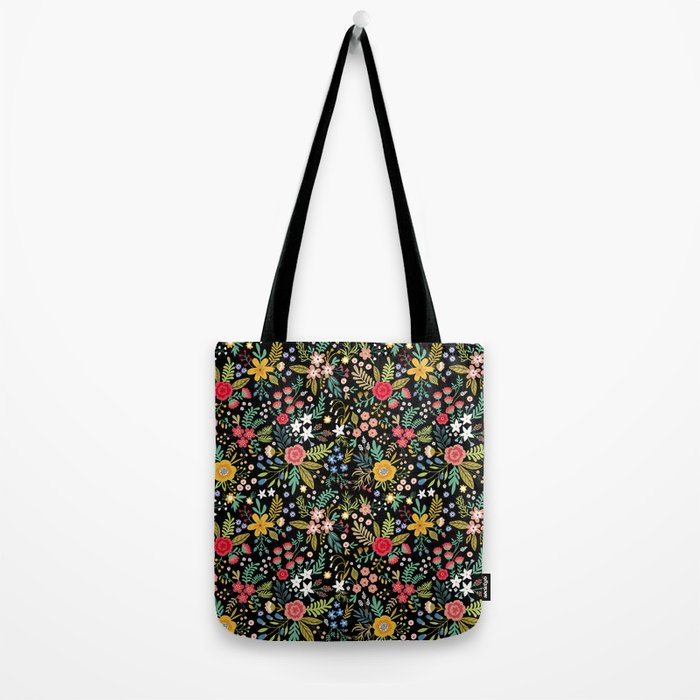 Amazing floral pattern with bright colorful flowers, plants, branches and berries on a black backgro Umhängetasche