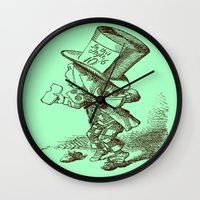 mad hatter Wall Clocks featuring Mad Hatter by Public Domain
