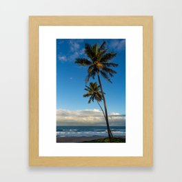Sunset on the edge of the sea. Two huge palm trees pointing to the sky. Framed Art Print