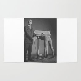 Pillory - Naked woman locked in a wooden pillory Rug