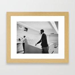 Pushing buttons Framed Art Print