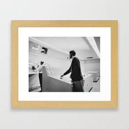 Pushing buttons Framed Art Print