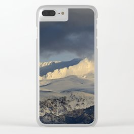 Snowy mountains through the clouds. Clear iPhone Case