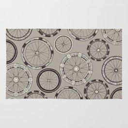 bike wheels stone Rug