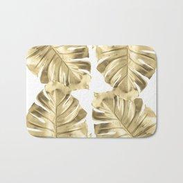 Gold Monstera Leaves on White Bath Mat
