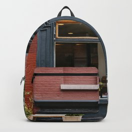 Picturesque restaurant in Greenwich Village, New York Backpack