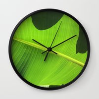 banana leaf Wall Clocks featuring Banana Leaf, Dark Shadows by Glenn Designs