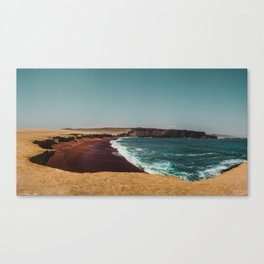 Red Beach 'Playa Roja' in the Paracas desert meets the Pacific Ocean in Peru Canvas Print