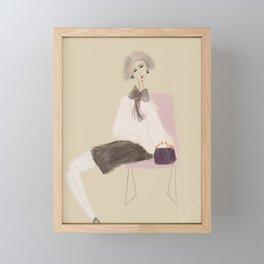 Lady sitting on modern chair Framed Mini Art Print