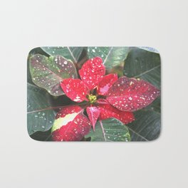 Raindrops on a poinsettia Christmas flower Bath Mat