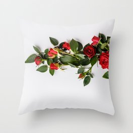 Cup with red roses on white background Throw Pillow