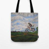moto Tote Bags featuring Moto Jump  by Chloe Metcalfe