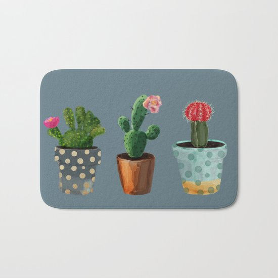 Three Cacti With Flowers On Blue Background Bath Mat