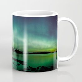 Northern lights panorama over lake landscape in Finland Coffee Mug
