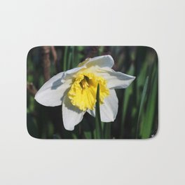 The first flowers in the park. Bath Mat