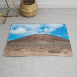 Lonely Mountain rise above the land in the Canary islands Rug