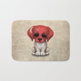 Cute Puppy Dog with flag of Singapore Bath Mat
