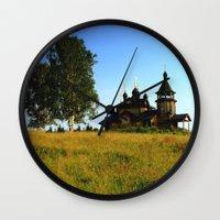 russia Wall Clocks featuring Wooden Church, Merkushino, Russia by Svetlana Korneliuk